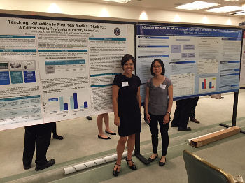 Two early career physicians with their posters: Amy Hayton, MD and Kathie Huang, MD, FACP