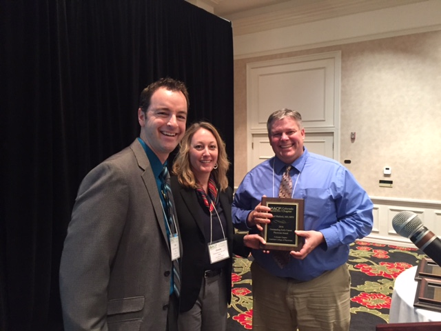 Chad Stickrath and Christie Reimer, MD, FACP, with CECP Award winner Dan Matlock, MD, FACP