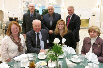 Joseph Andrews, seated second from left, front row, pictured with colleagues from CT Hospice
