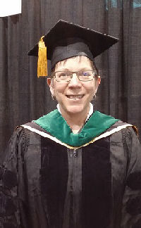 Elizabeth Olberding, MD, FACP walked in Convocation