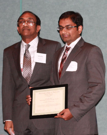 Dr. Sri Rama Kattula presented with Resident of the Year Award by Dr. Sajan Thomas