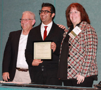 Dr. Sunny Sharma presented with Resident of the Year Award by Dr. Max Harris and Dr. Karen Weinstein