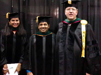 Indiana Chapter Fellows, left to right: Dr. Shilpee Sinha and Dr. Surendra Sha with Dr. Neal