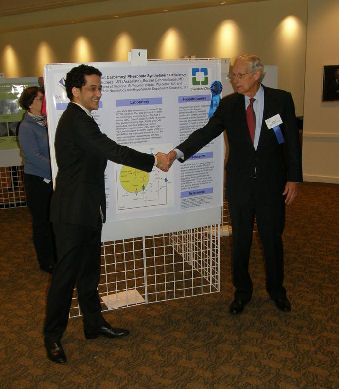 Clinical Vignette Poster Winner, Dr. Edrees being congratulated by Dr. Dupee