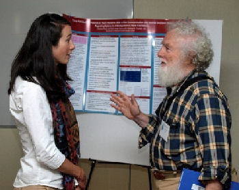 Resident Christina Perron, DO discusses her poster with Richie Kahn, MD MACP