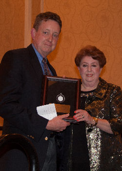 Skip Nolan, MD, FACP receiving the Laureate Award from Helen Turner, MD, MACP