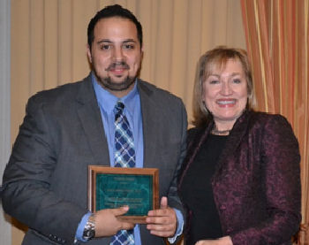 Dr. Ziad Dimachkie receiving a Special Recognition presented by Dr. Darilyn Moyer
