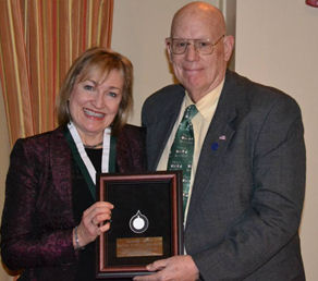Dr. Darilyn Moyer being presented a Laureate by Dr. Dan Kimball, Governor Eastern Region