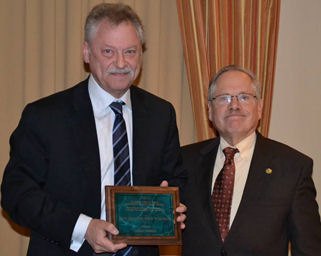 Dr. Ed Ruby (left) receives the Waxman Award, presented by Dr. Arnie Eiser during the Annual Awards dinner in December.