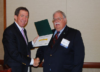 Robert M. Centor, MD, MACP presenting the 2014 Chapter Excellence Award from ACP.