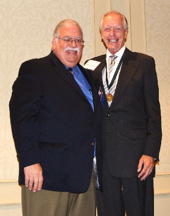 William Schaffner, MD, MACP receiving award from Dr. Lane