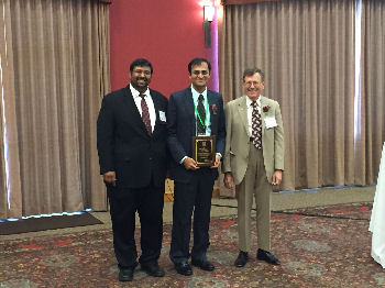 Dr. Rupesh Prasad, FACP from Brookfield, WI accepts the 2015 ACP-WI Young Internist of the Year Award from ACP-WI Governor, Dr. Mark Belknap, FACP and his nominator, Dr. Vipul Rana, FACP. The Young Internist Award recognizes the outstanding contributions of a young internist in primary care and medical education.