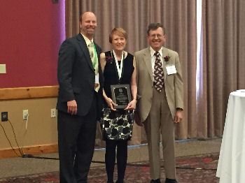 Dr. Ann Nattinger, MACP, from Milwaukee, WI accepts the 2015 ACP-WI Laureate Award from ACP-WI Governor, Dr. Mark Belknap, FACP and her nominator, Dr. Kurt Pfeifer, FACP. The Laureate Award is given to Fellow or Master of the College who demonstrates by example and conducts an abiding commitment to excellence in medical care, education, research and service to their community and the College