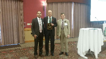 Dr. Michael O'Brien, FACP of La Crosse, WI accepts the 2015 ACP-WI Community-Based Physician and Mentor Award from ACP-WI Governor, Dr. Mark Belknap, FACP and his nominator, Dr. Umesh Sharma, FACP. The Community-Based Physician and Mentor Award recognizes an exceptional community preceptor who has demonstrated a commitment to the mentoring of medical students and/or residents outside of major teaching centers.